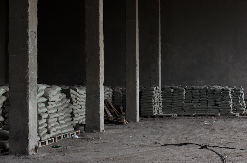 Bags of cement are stored at the DRC warehouse in Osh, Kyrgyzstan. December 2011.