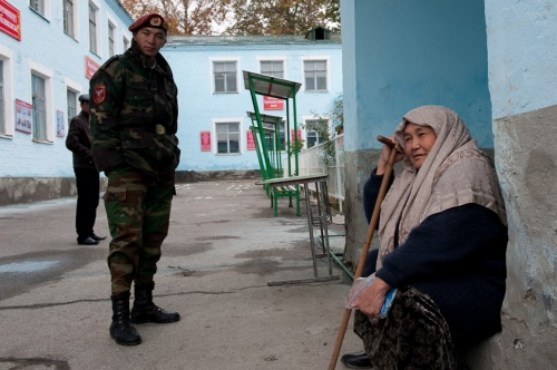 A woman rests outside of a polling station after voting in Osh, Kyrgyzstan on October 29, 2011.