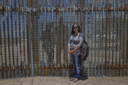 Family portrait. Rosario Vargas(in the foreground) with her daughter Jannet Castañon and grandson Hector, 15, (behind the border wall, on the U.S. side.) Rosario and her daughter live just a few miles apart but have been separated by the U.S-Mexico border wall for almost 10 years. On April 30, 2016, they were one of the few families who were allowed to briefly reunite for 3 minutes when a small door in the fence was opened.But once the door of hope was closed, the reality of the border hit them again.They see each other every weekend through the metallic fence.