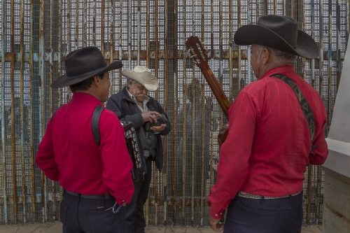 Jose Marquez hires Mexican norteño musicians to sing a song to his daughter Susana, 33, and grandson Johnny, 14, who live in California and meet with him every month at the border wall. The have not been together in 14 years since Marquez was deported.