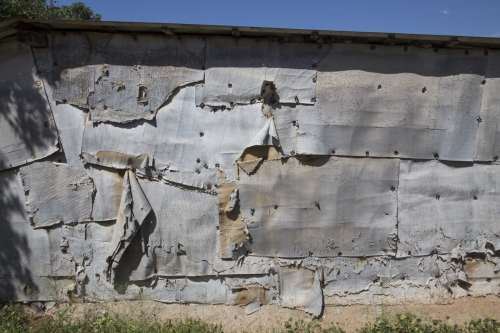 Dilapidated cardboard wall. Many laborers in the San Quintin valley use cardboard as a primary material for building their houses.