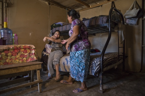 Eduarda Lezma with her 24 year old daughter Adali. Adali is mentally disabled and needs constant supervision.