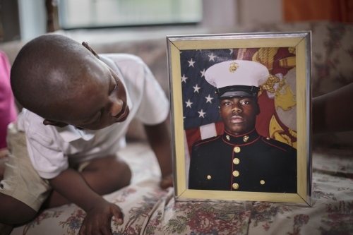 Didier Mejia looks at his cousin's military photograph. Many immigrants join the U.S. military as a way to assimilate and obtain their citizenship. There are approximately 30,000 non-citizens currently serving in the US military.