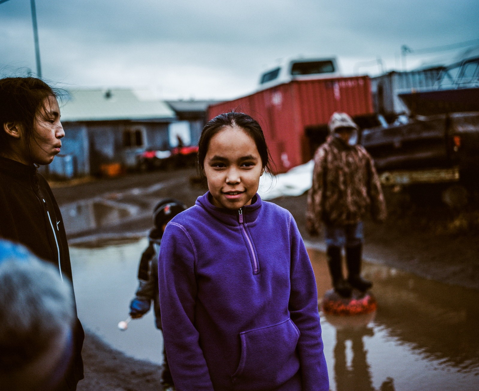 Adolescents and children gather in the street on a fall Sunday evening in Kivalina, Alaska.