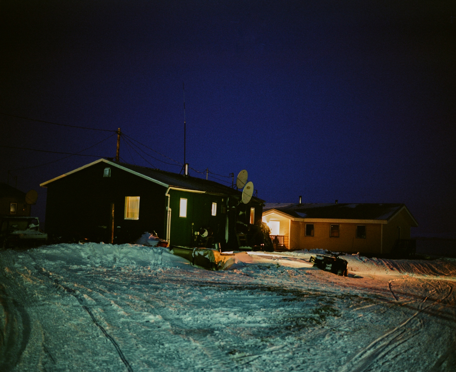 Homes in Kivalina, Alaska after dark. In the winter time, the village experiences only a few hours of light each day and less than and hour on its darkest days of the year.
