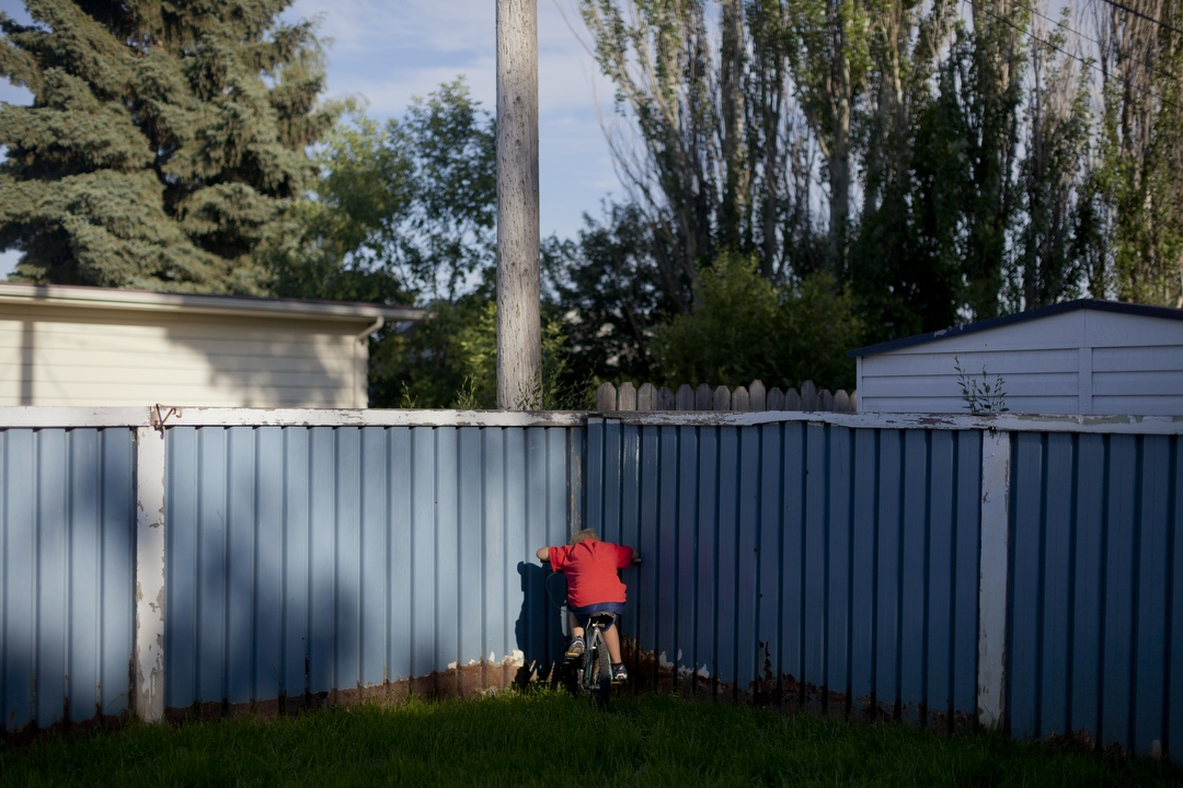 A child rests on a summer day in Williston, North Dakota. (Williston, ND / July 4, 2013)