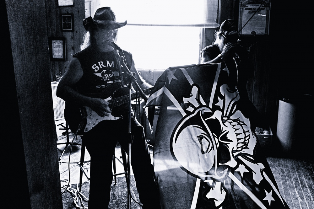 Photography image - Singer/Songwriter Michael Patrick Sullivan, who bills himself as the Traveling Troubadour, accompanied by a friend on harmonica, play country and rebel-rock standards at the American Legion in New Haven, Illinois on Sunday afternoon, June 26.