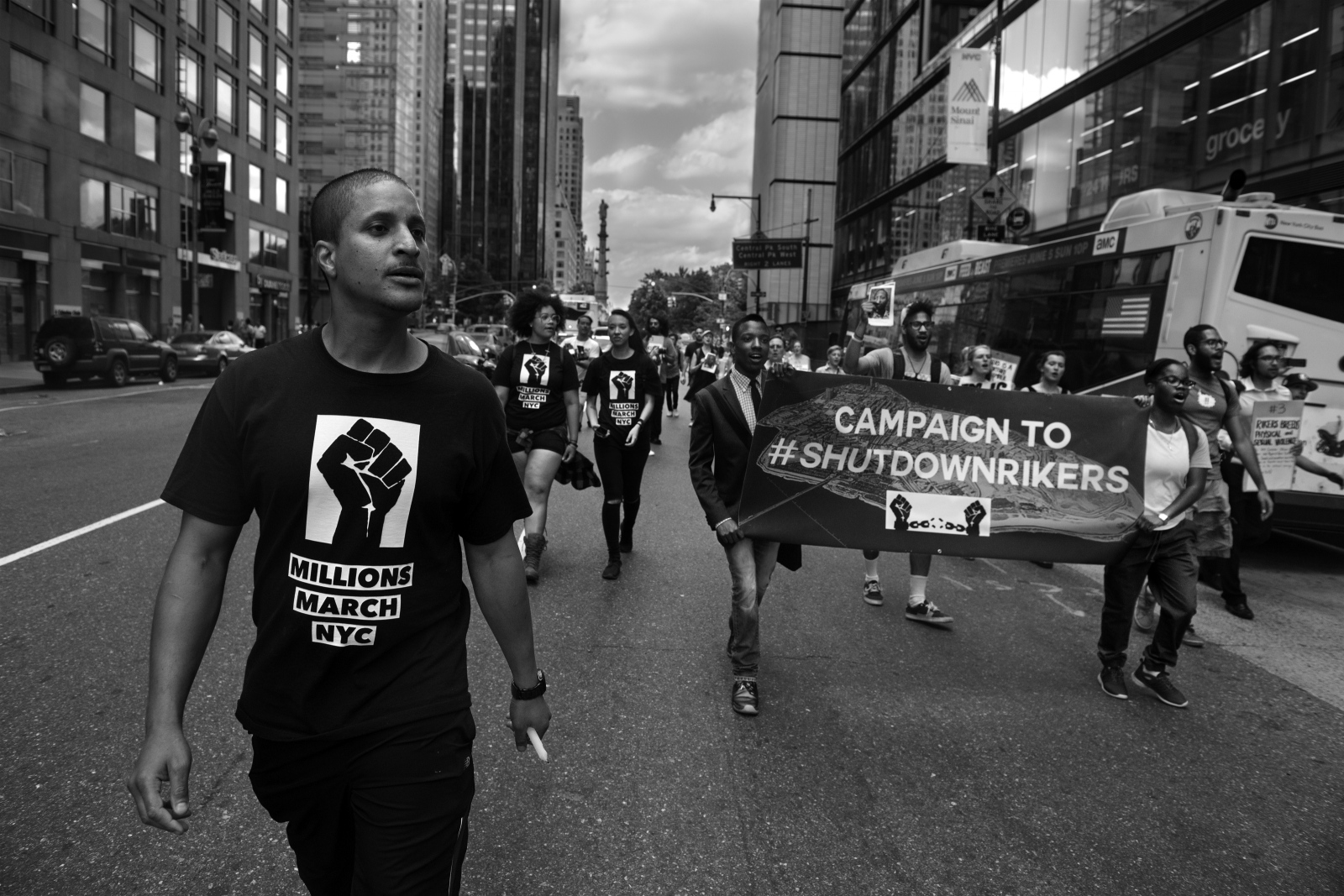 Akeem Browder and members of the Campaign to #ShutDownRikers walk down sixth avenue on the day of the first anniversary of the death of Kalief Browder, Akeem's brother.  June 6th, 2016.