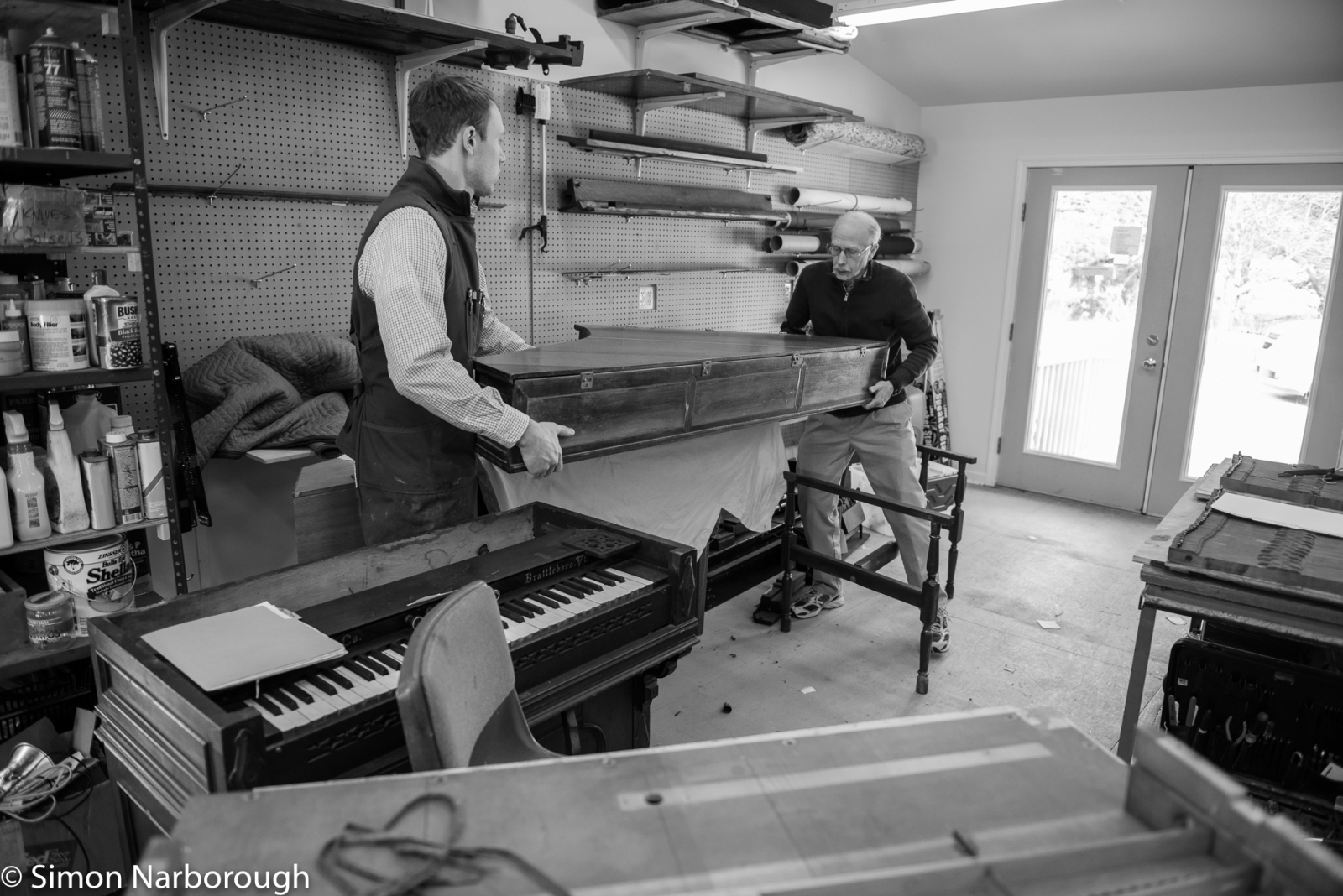 Shifting a harpsicord that is scheduled to be restored.