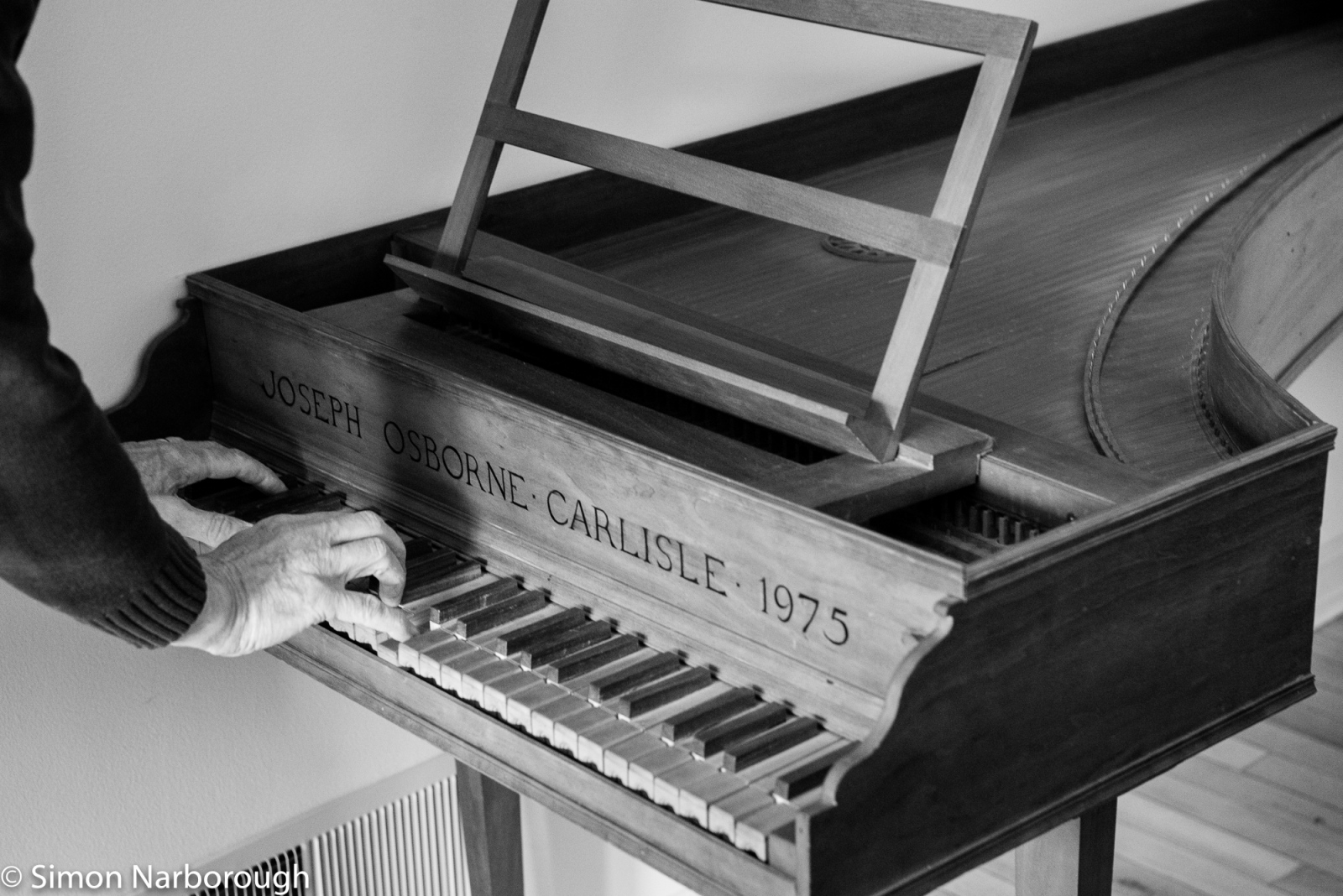 Joseph plays a harpiscord that he built in the 1970's