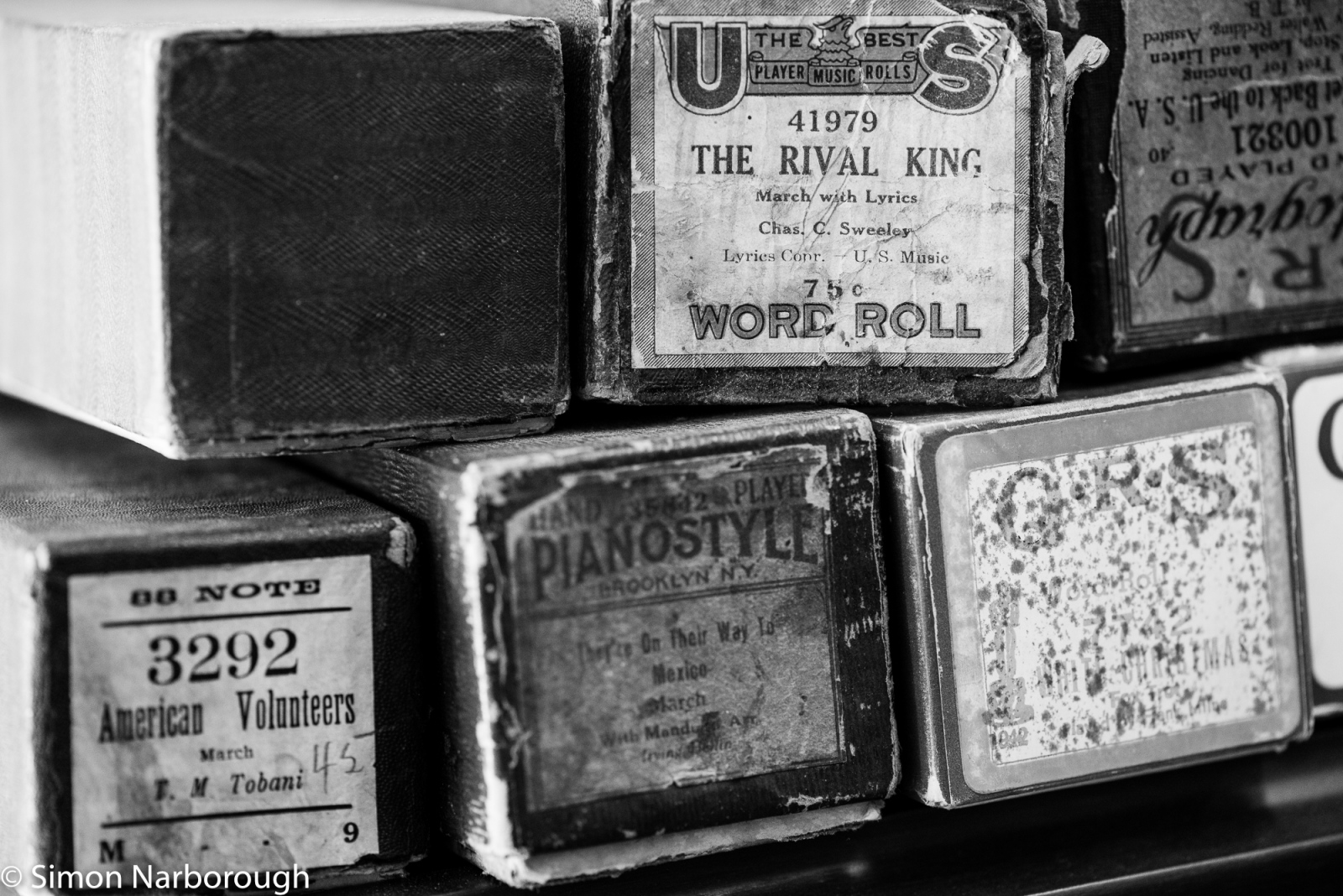 Some of the old player piano rollers that have been collected.