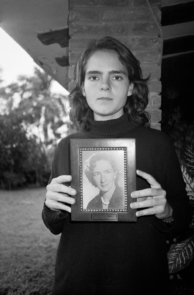 Natali Montel, a recent graduate from film school lwith a photo of her grandmother, Sara Garcia Iglesias, Ozuluama, Ver 2010 ©Sylvia de Swaan