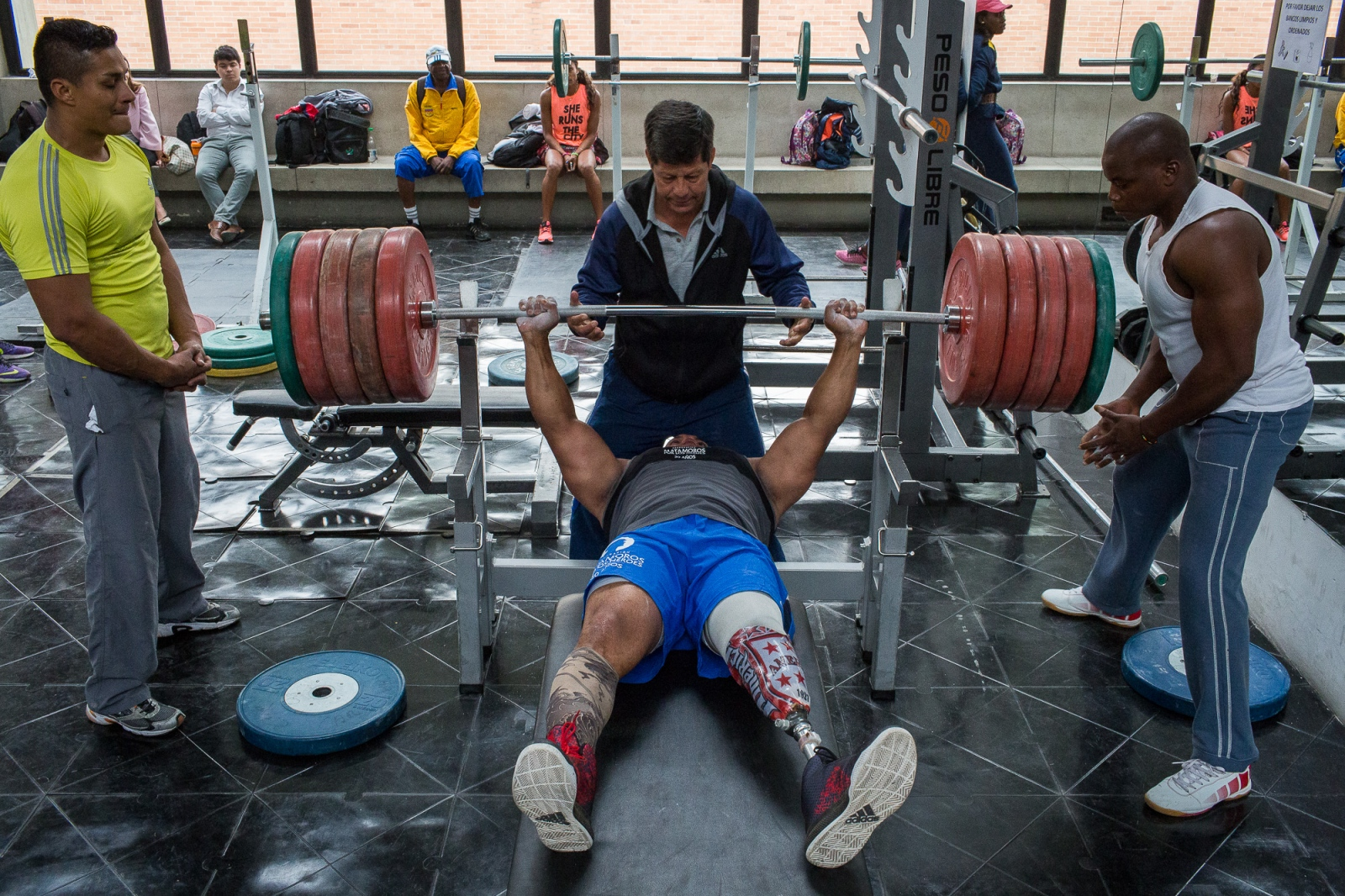 Fabio Torres, 39, lifts 240kgs under the supervision of his coach Henri Oviedo during a training session in the High Performance Center, Bogotá, 7th June, 2016.