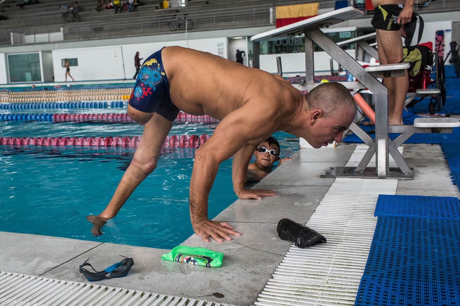 Moises Fuentes Garcia, 41, does pushovers on the border of a pool after a training session at the Simon Bolivar Aquatic Complex, Bogotá, 3rd June, 2016.