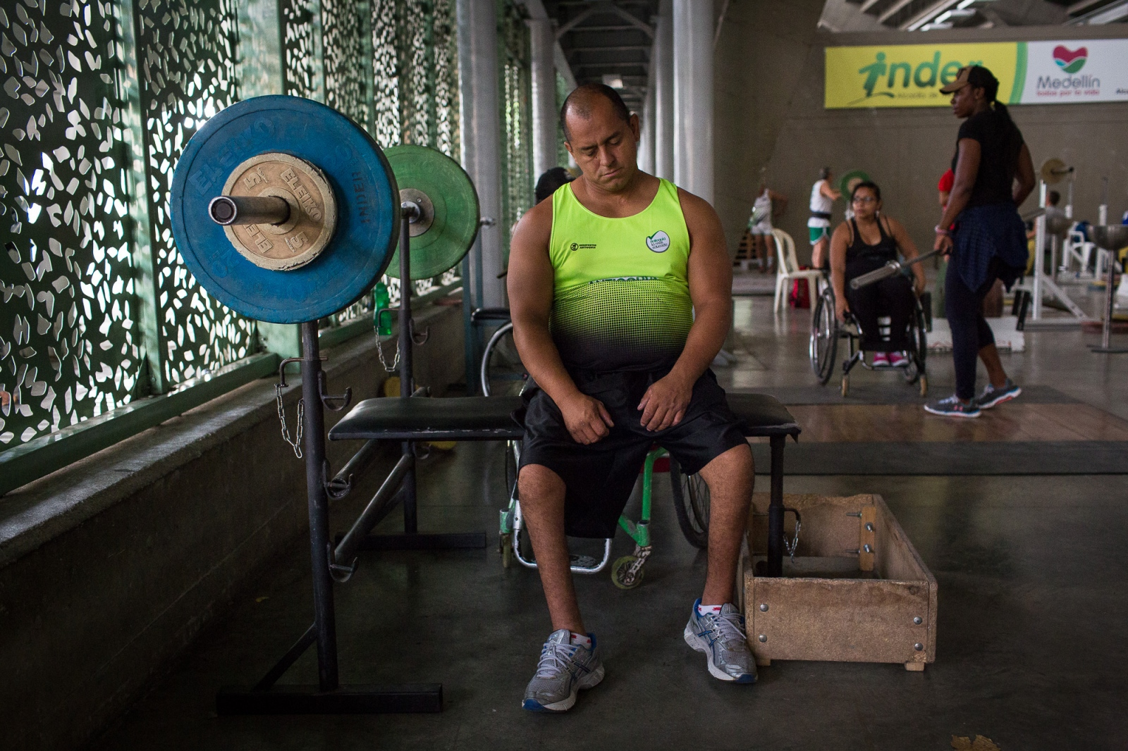 Joe Gonzalez Bettencourt, 38, tries to relax after some weight lifting exercises in the gymnasium at Atanasio Girardot Stadium, Medellin, 10th March, 2016.