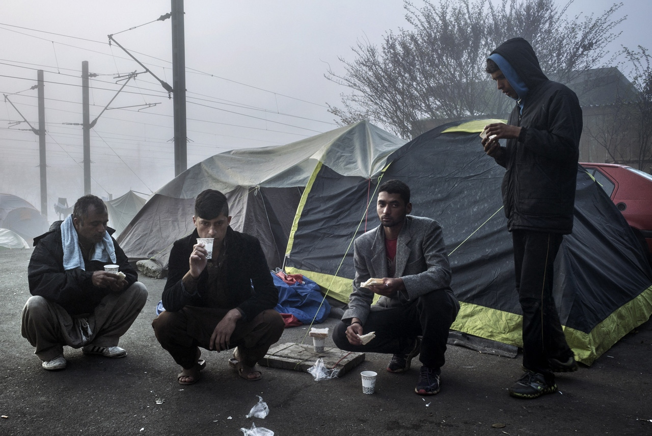 Asylum seekers from Pakistan have breakfast at early morning.