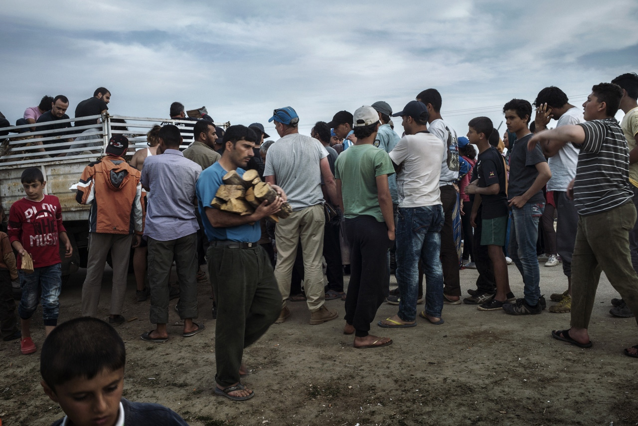 "Everyday a group of International volunteers called ""Bomberos"" provides planks for refugees."