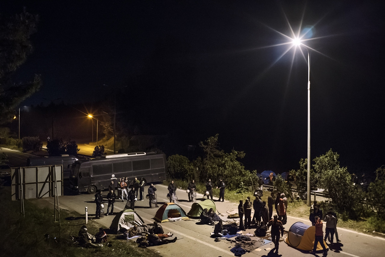 Refugees block the highway which connects Greece and Macedonia.