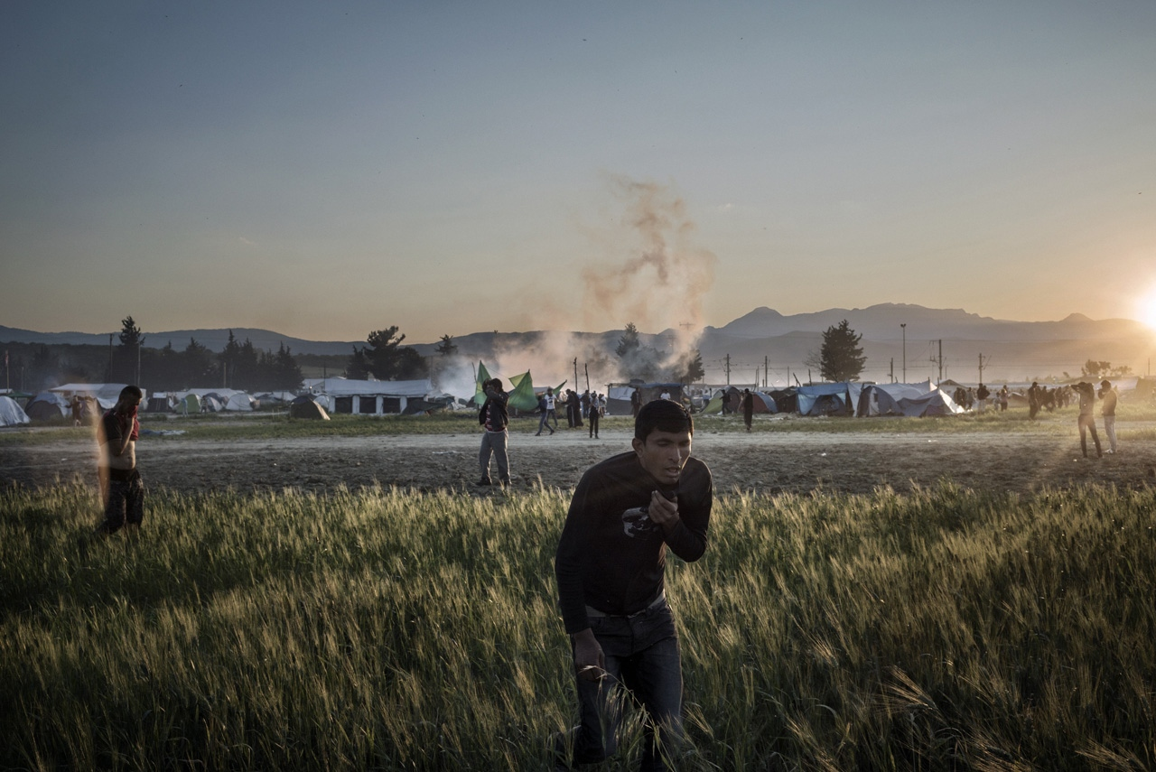 Refugees pushed a train towards a police line during a protest at Camp Idomeni, after which clashes ensued. Protesters threw rocks and police retaliated with tear gas.