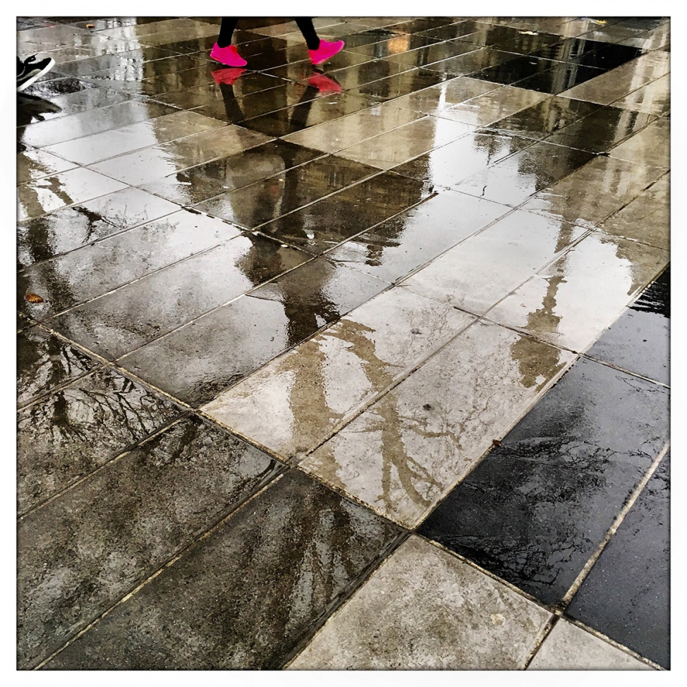 Fuchsia shoes add color to an otherwise grey and rainy day in Paris.