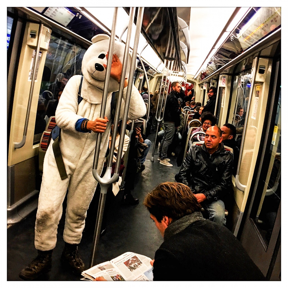 A polar bear rides the Paris subway during the Climate Change Summit 2015 held in Paris.