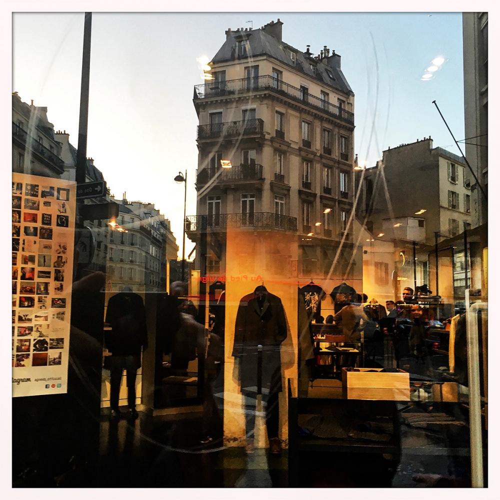 Parts of Paris are reflected in Agnès b's men's store.