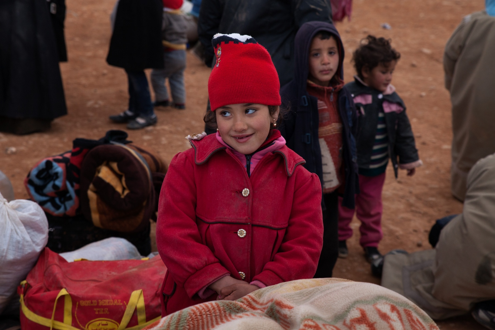 A young Syrian girl is thrilled to be in safe hands.