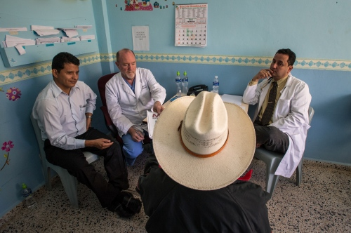 Doctors withCentral American Medical Outreachlisten to a patient during cosultations Feb 22, 2014at Occidente Hospitol in Santa Rosa de Copan, Honduras. CAMO provides medical needs to thousands in and around Honduras, fromgeneral medicine, togynecological, breast exams, basic dental procedures, neurosurgery, plasticsurgery, or ophthalmology. Photo Ken Cedeno