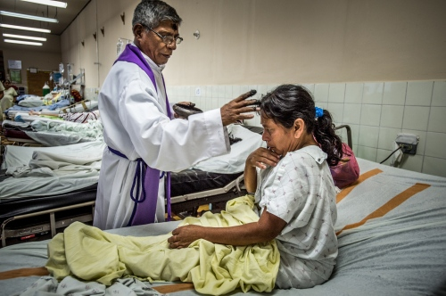 A local preist blesses a patients on Ash Wednesday at Occidente Hospital March 5, 2014in Santa Rosa de Copan, Honduras. CAMO, Central American Medical Outreach works with Occidente Hospital, to provide medical needs to thousands in and around Honduras, fromgeneral medicine, togynecological, breast exams, basic dental procedures, neurosurgery, plasticsurgery, or ophthalmology.Photo Ken Cedeno