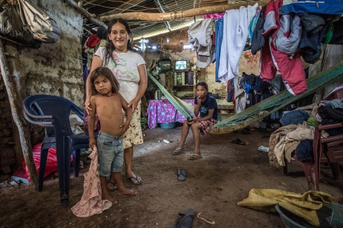 A family poses in their home in the hillside area Oct 6, 2014just outside of Santa Rosa de Copan, Honduras. Central American Medical Outreach, CAMO, provides medical needs to thousands in and around Honduras, fromgeneral medicine, togynecological, breast exams, basic dental procedures, neurosurgery, plasticsurgery, or ophthalmology. Photo Ken Cedeno