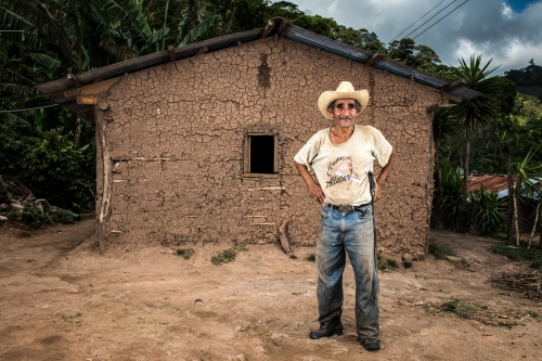 A local farmer poses in front of his home in the hillside area Oct 7, 2014just outside of Santa Rosa de Copan, Honduras. Central American Medical Outreach, CAMO, provides medical needs to thousands in and around Honduras, fromgeneral medicine, togynecological, breast exams, basic dental procedures, neurosurgery, plasticsurgery, or ophthalmology. Photo Ken Cedeno