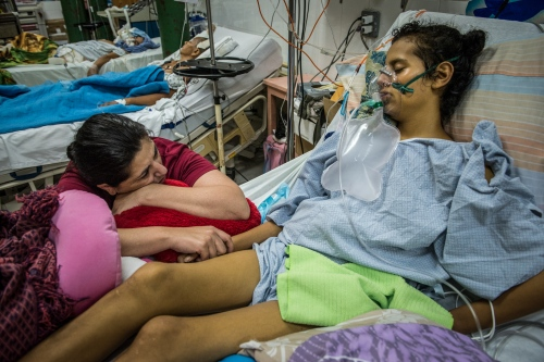 Eblin Fuentes, left, prays for her daughter Fernanda who recently celebrated her 14th birthday Oct 30, 2014at Occidente Hospital in Santa Rosa de Copan, Honduras. The staff at CAMO, (Central American Medical Outreach), helps out with the community in and around Santa Rosa de Copan, Honduras. Whether it's people right in town or from as far away as 10-12 hours. People travel by car, hitchhiking, horse, bus, or walk to receive these benefits. Photo Ken Cedeño