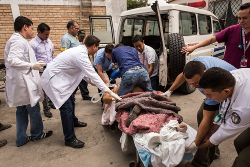 Medical emergency crew work on saving an incoming ambulance patient from a large bus accident 15 miles outside of Santa Rosa de Copan, Honduras Oct 31, 2014. The staff at CAMO, (Central American Medical Outreach), helps out with the community in and around Santa Rosa de Copan, Honduras. Whether it's people right in town or from as far away as 10-12 hours. People travel by car, hitchhiking, horse, bus, or walk to receive these benefits. Photo Ken Cedeño