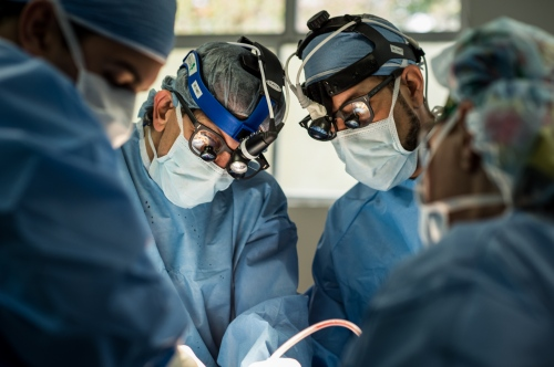Neurologists Dr. J.C. Tabet center left, and Dr. Roberto Alvarez, center right, operate on a patient Nov 4, 2015 in Occidente Hospital in Santa Rosa de Copan, Honduras. THestaff at CAMO, (Central American Medical Outreach), helps out with the community in and around Santa Rosa de Copan, Honduras. Whether it's people right in town or from as far away as 10-12 hours. People travel by car, hitchhiking, horse, bus, or walk to receive these benefits. Photo Ken Cedeño