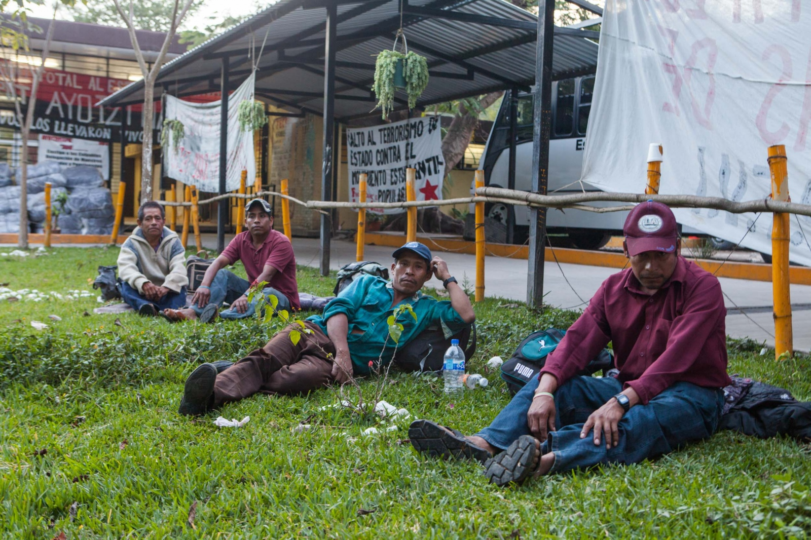 · Farmers of the mountain of Guerror rest for a little while outside of the cafeteria after spending several days campingo out on the school helping out the parents and students.   // · Campesinos de las montañas de Guerrero descansan un momento afuera de la cafetería después de pasar varios días en la escuela, prestando solidaridad a los padres de los alumnos desaparecidos.