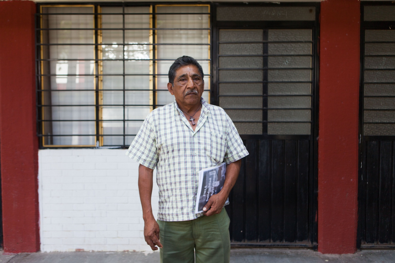 "· Don Ezequiel Mora poses in front of one of the classroom after a conversation in which he seemed enthusiastic that his son was still alive, hopeful that wherever he was, even if it was a military compound or working on the amapola fields of one of the drug traffickers, he woudl be safe. Alexander Mora, his son, was the first to be ""oficially"" found in a dumpster where supposedly the boys where incinerated, only leaving as evidence a bone belonging to him as confirmed by Argentinian experts investigating the case. Don Ezequiel, along with the other parents doubt the results. // · Don Ezequiel Mora en frente a uno de los salones de la escuela después de una platica en la que se mostraba entusiasta de que su hijo estaría vivo, contemplando la posibilidad de que estuvieran trabajando en un cuartel militar o en alguna plantación administrada por los narcos. Su hijo, Alexander Mora, fue el primero que tuvo los restos identificados via su ADN encontrado en un basurero, por el equipo argentino forense que se ha encargado de hacer la labor investigativa. Don Ezequiel, como los otros padres dudan del veredicto."