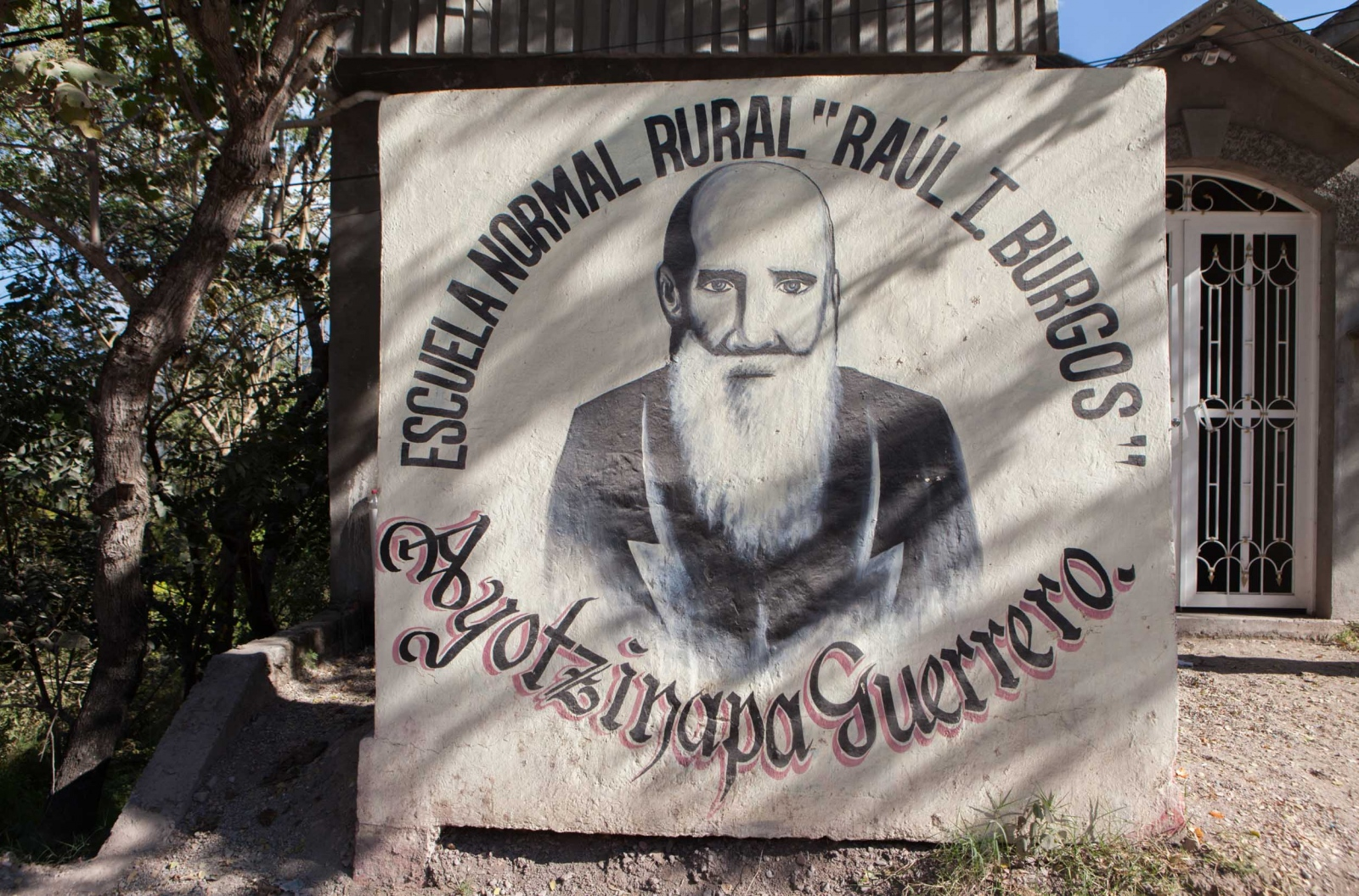 Image of Raul Isidro Burgos, a Mexican poet and teacher and the second pricipal of the Rural Teachers school of Ayotzinapa, at the entrance of the school territory. // Imagen de Raul Isidro Burgos, poeta, maestro y segundo director de la Normal Rural de Ayotzinapa, en la entrada principal de la escuela.
