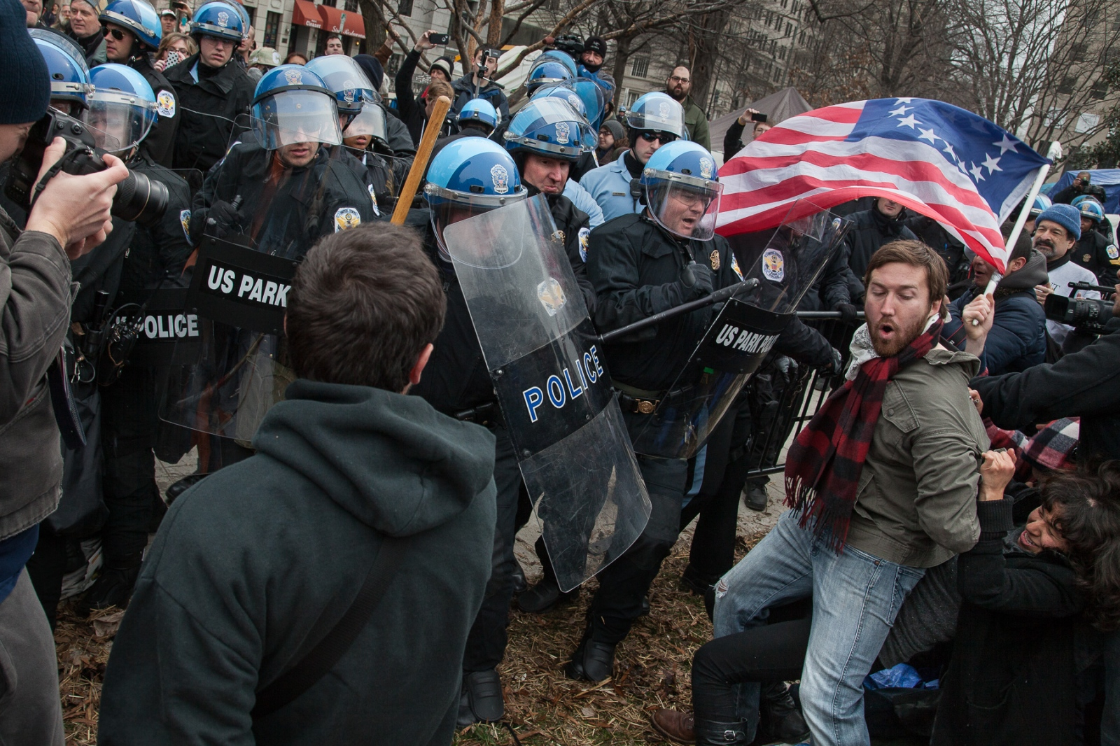 Occupy D.C. protestors try to resist as U.S. Park Police clear out areas of McPherson Square that will be inspected.