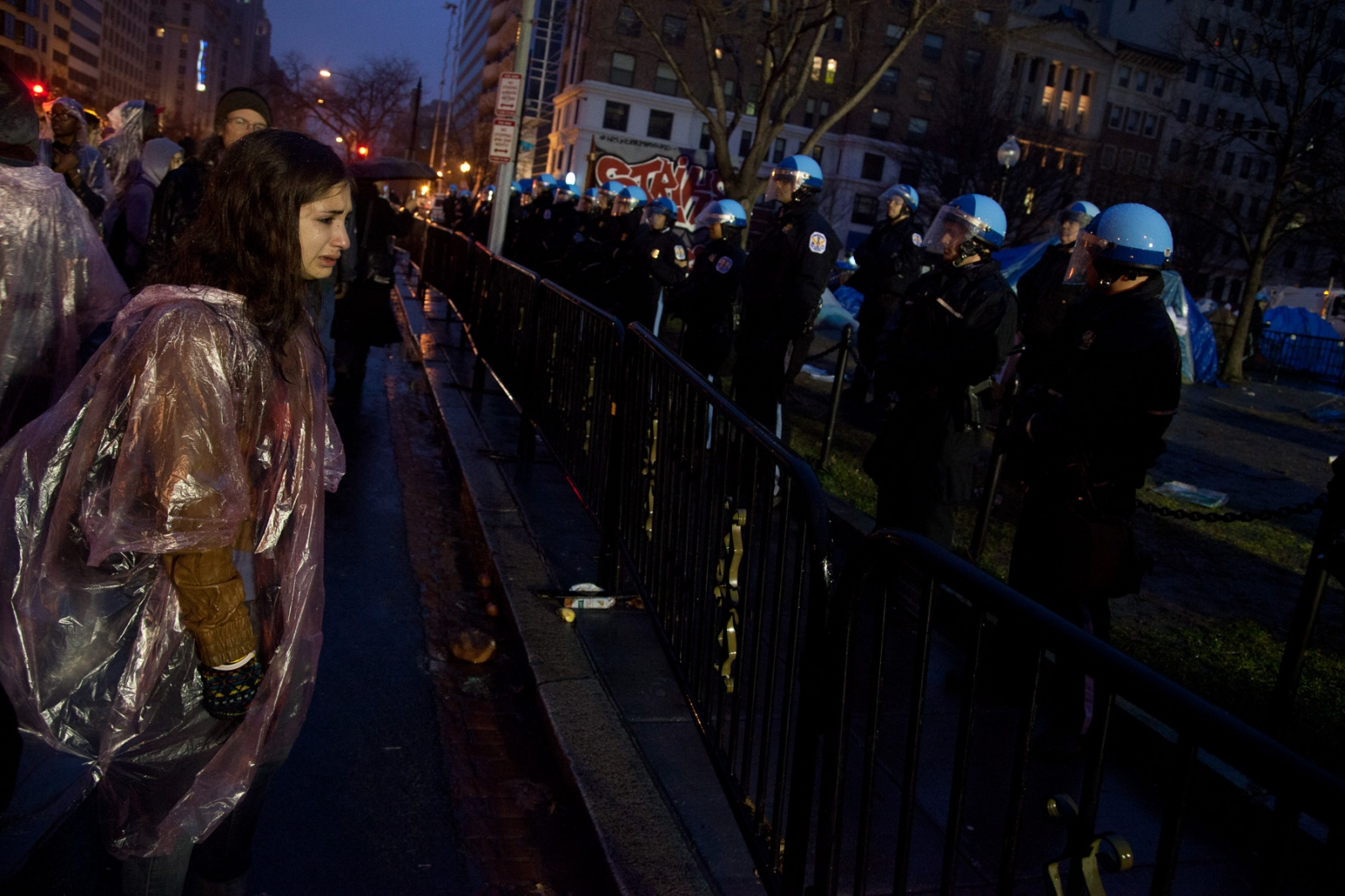 An angry protestor looks on in disbelief as it becomes apparent that Occupy DC has lost McPherson park.