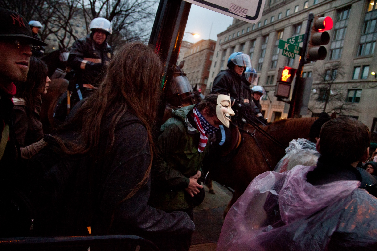 U.S. Park Police on horseback force out the last protestors in McPherson Square.
