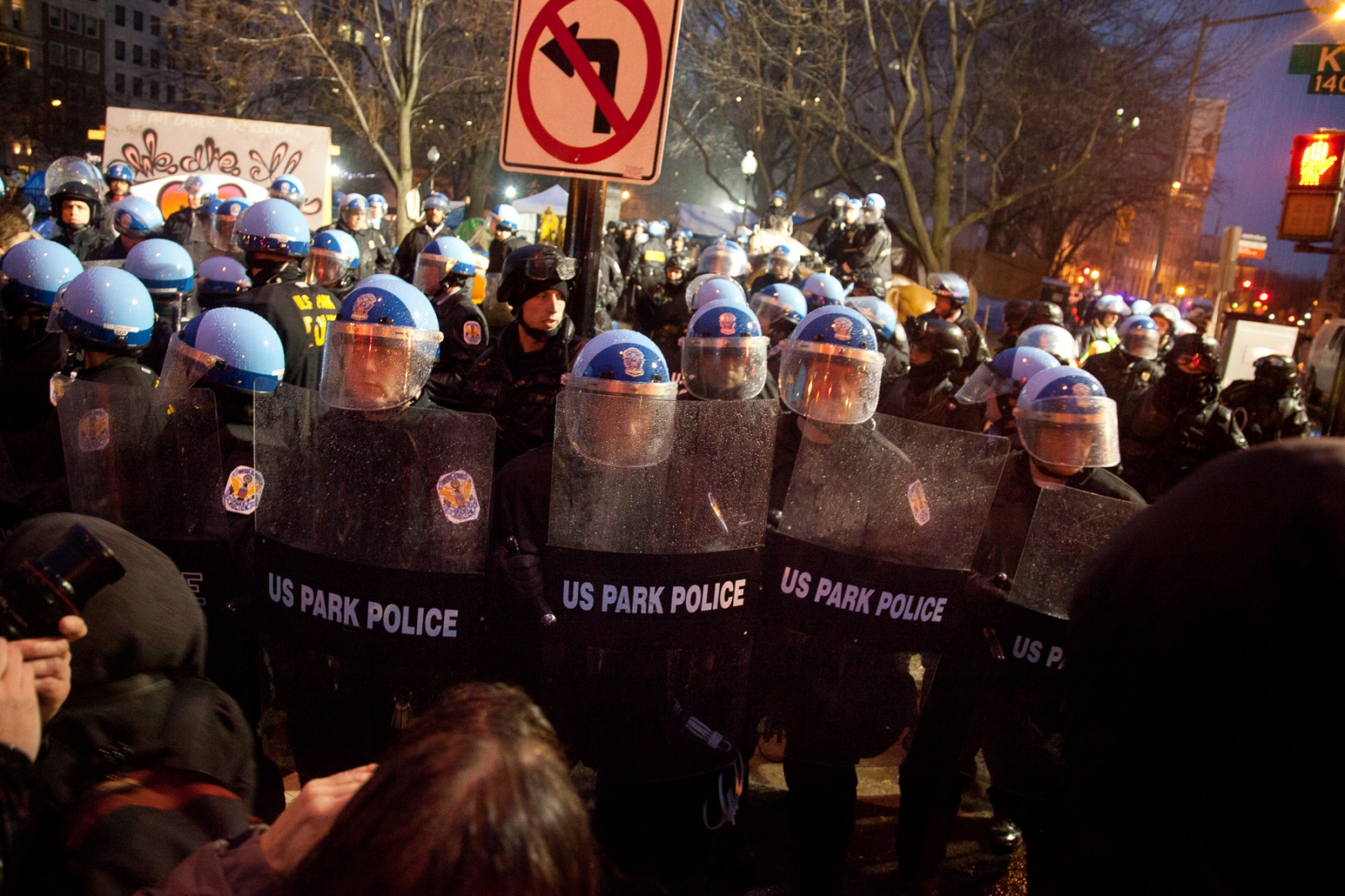 U.S. Park Police form a solid wall in front of McPherson Square after evicting the last Occupy D.C. protestors from it.
