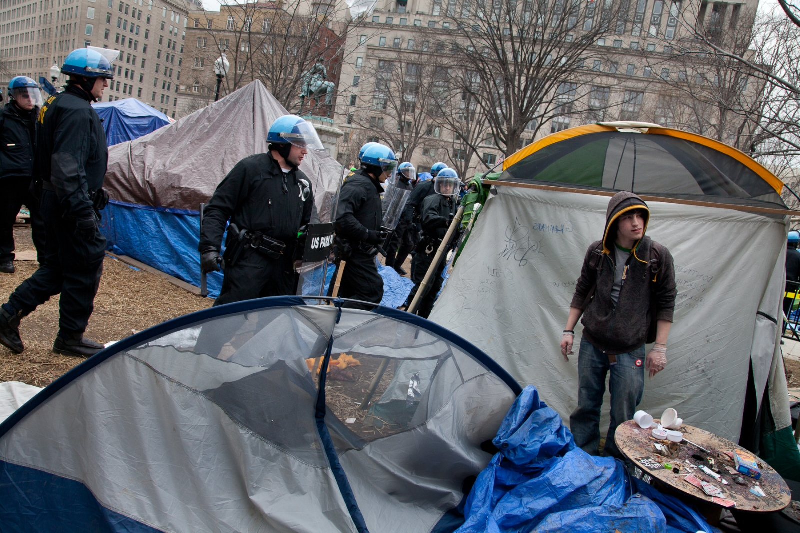 An Occupy D.C. protestor tries to figure his next move as U.S. Park Police move through the camp in preparation for removing tents and anything else deemed illegal to keep on federal park property.