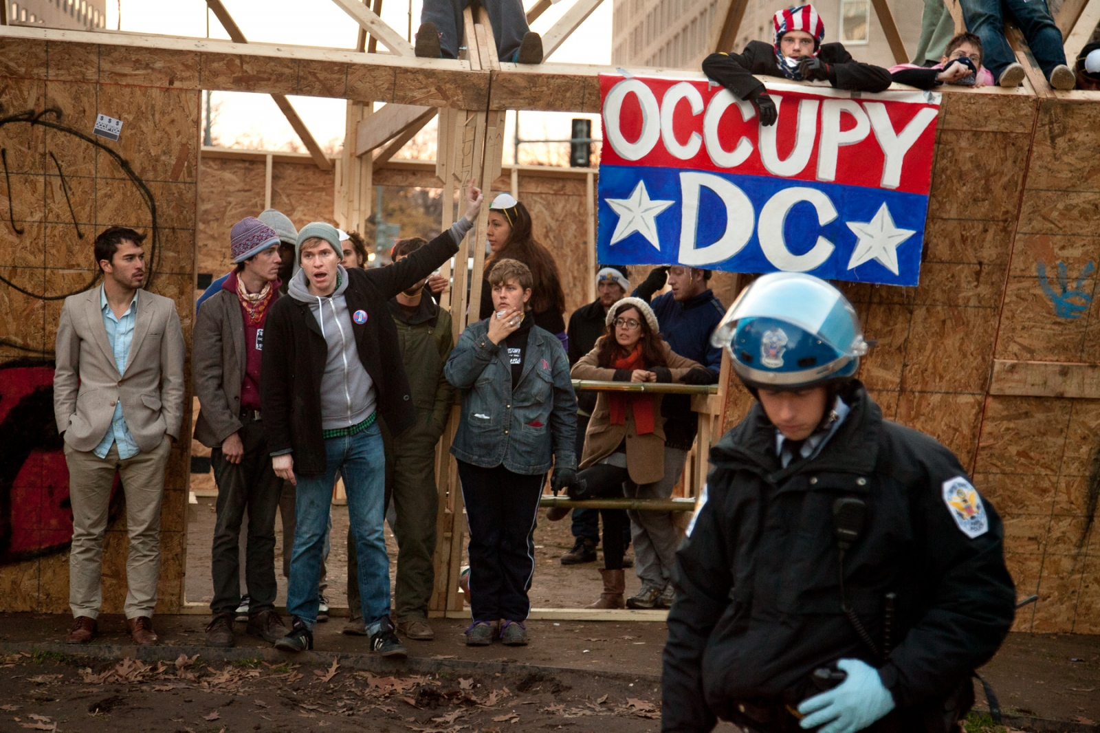 Occupy D.C. protesters refuse to leave the wooden shelter they erected, creating a day-long standoff with the U.S. Park Police.