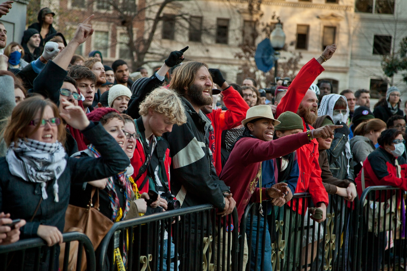 Angry Occupy D.C. protestors scream at U.S. Park Police, who are preparing to arrest demonstrators barricaded in a wooden structure they errected overnight.