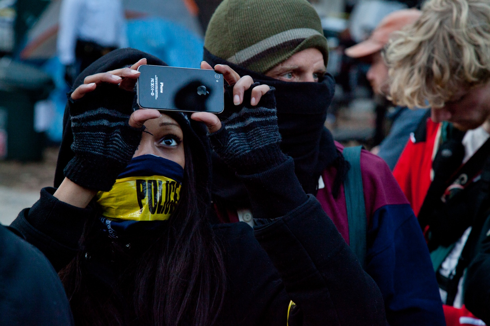 An Occupy D.C. protestor documents the action on her iPhone.