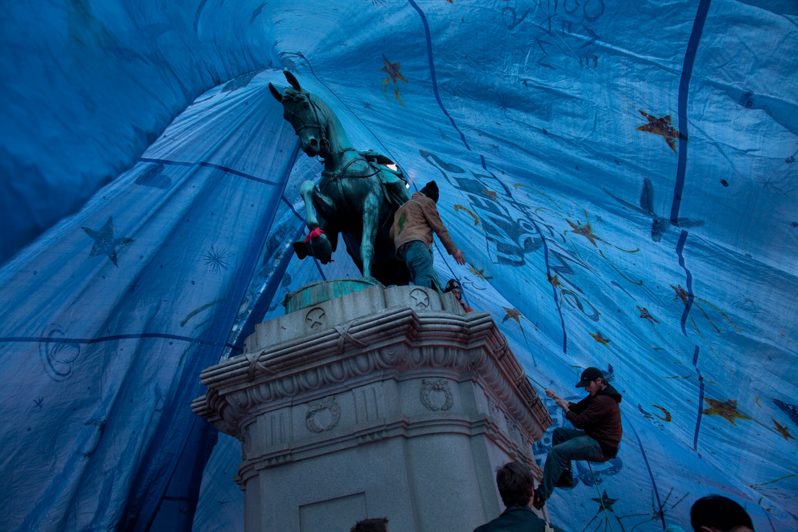 """Occupy DC protestors succeed in putting a tarp over the Statue of General James B. McPherson, which they dubbed the """"Tent of Dreams."""""""