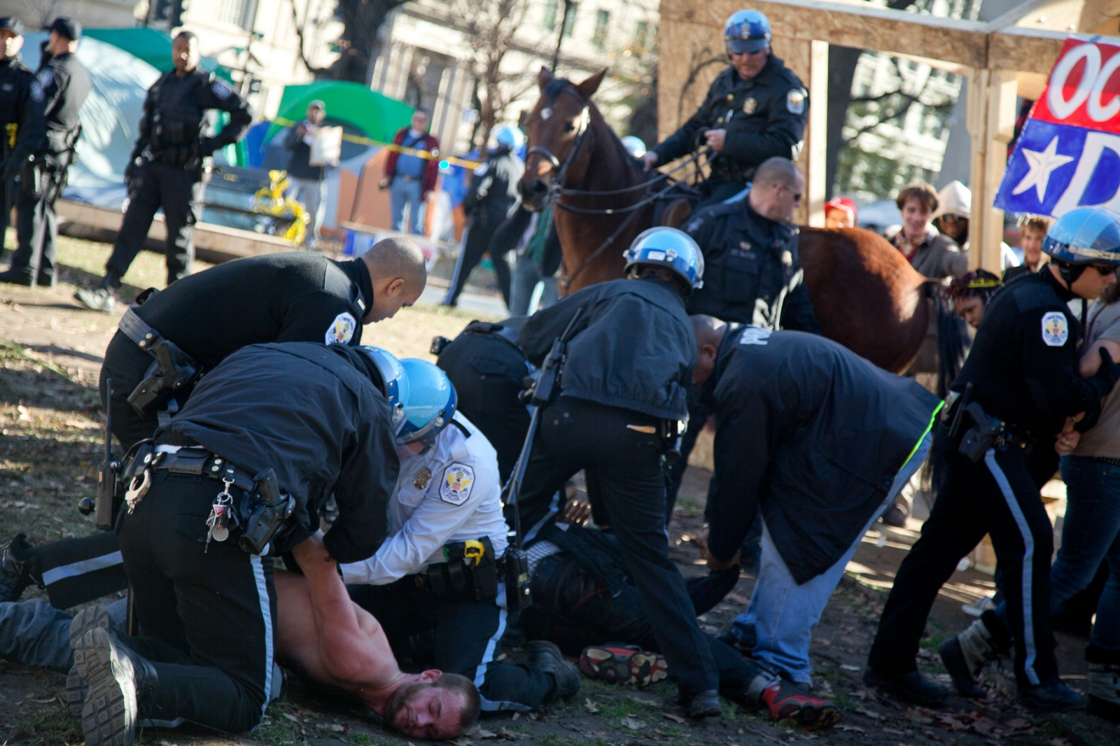 U.S. Park Police arrest protesors who broke through the police line in an effort to join fellow Occupy D.C. protestors barricaded in a wooden structure they erected in McPherson Square.