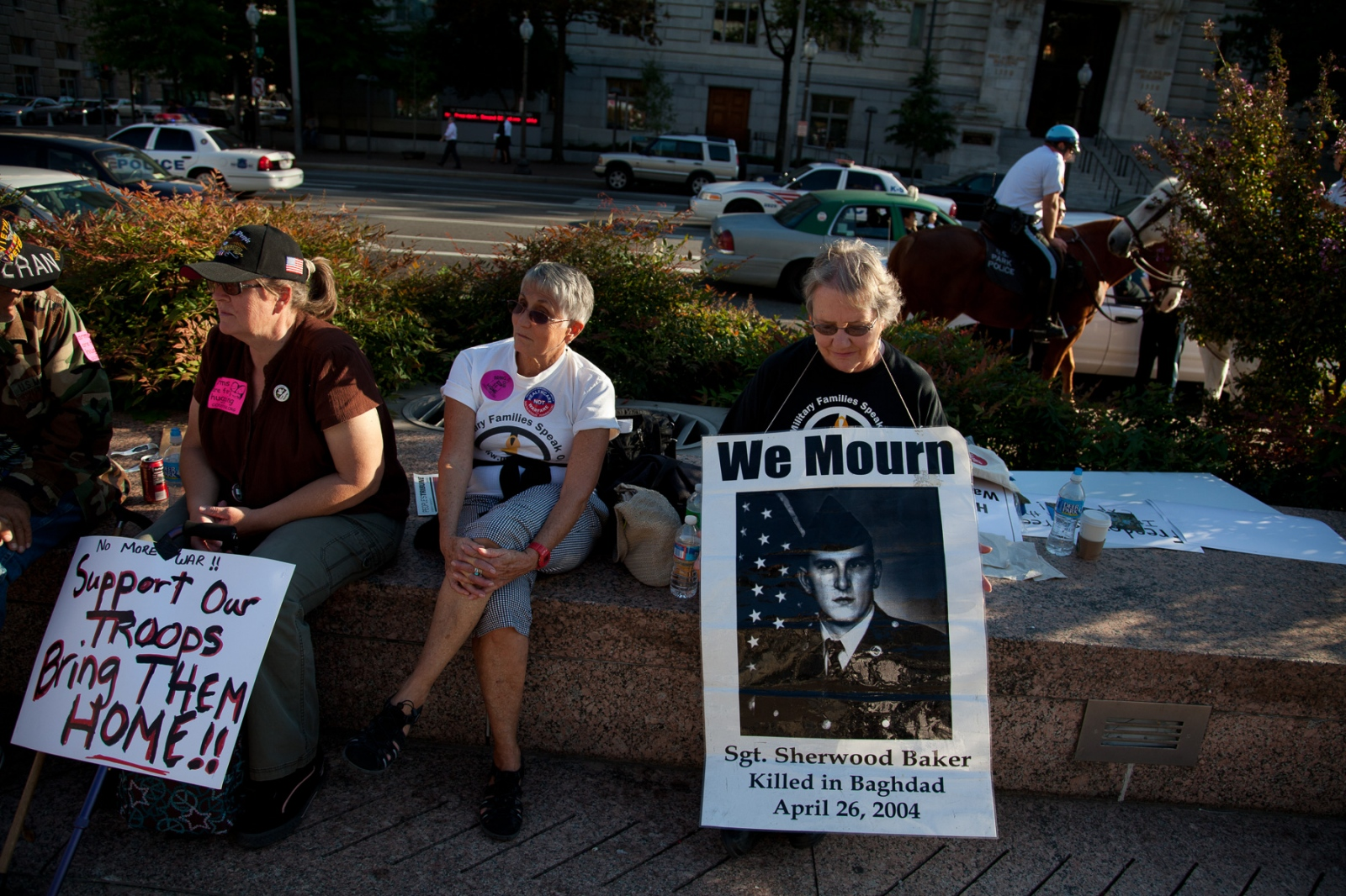 """Celeste Zappala and members of """"Military Families Speak Out"""" quietly sat on one side of the square. Her son, who was the first Pennsylvanian guardsman to be killed since World War II, died in 2004 as his unit searched for non-existent weapons of mass destruction in Iraq: """"We decided when we buried him that we would keep speaking out. That's what I'm doing here."""""""