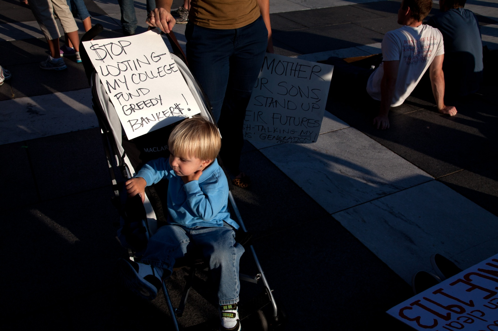 A mother and son bring their message to Freedom Square.