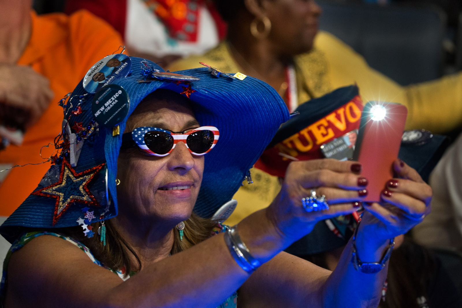 A delegate photographs the activity in front of her at the Democratic National Convention in Charlotte, NC